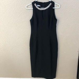 Midi length black dress